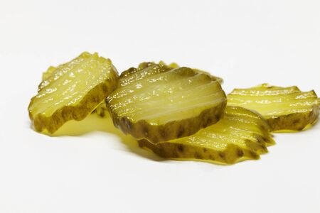 some slices of sandwich cucumber on white background