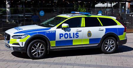 Umea, Norrland Sweden - June 20, 2020: Swedish police car has parked downtown on pedestrian street Редакционное