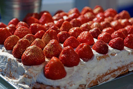 strawberry cake for midsummer with golden sprinkles