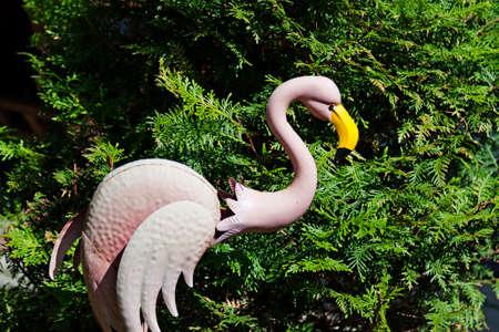 pink plastic flamongo in the garden