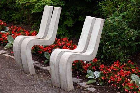 strange seats in park made of concrete 免版税图像