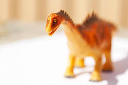 an unfortunate plastic toy dinosaur