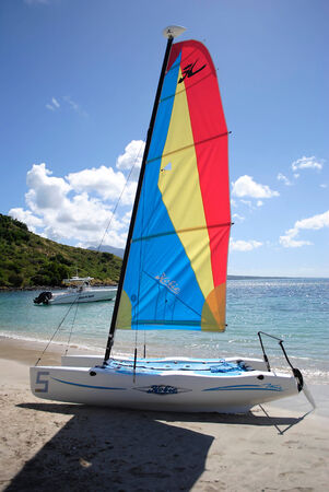 hobie: Reggy Beach in St Kitts is one of the Leeward Islands in the Lesser Antilles  JANUARY 19 2012  A catamaran on the silver sand beach for hire to the tourists Editorial