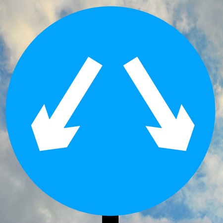either: Vehicles may pass either side to reach same destination traffic sign Stock Photo