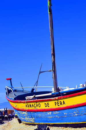 armacao: Colourful Fishing Boat on Fishersmans beach Armacao De Pera