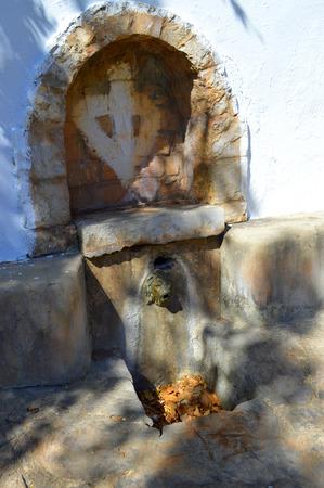 alte: Spring water drinking fountain in Alte village Stock Photo