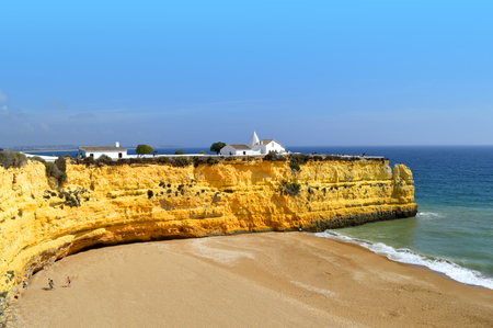 barlavento: The Chapel of Nossa Senhora da Rocha  on top of the spectacular cliffs on Nova Beach in Portugal