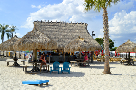 t bar: Ben T Davis Beach, Florida, USA - May 12, 2015:tourists at a beach bar enjoying a drink
