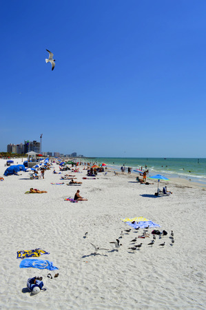 pinellas: Clearwater Beach, Florida, USA - May 12, 2015:tourists on the beach enjoying the sun Editorial