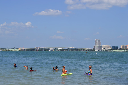pinellas: Sand Key in Florida, USA - May 10, 2015: tourists in the sea enjoying the sun Stock Photo