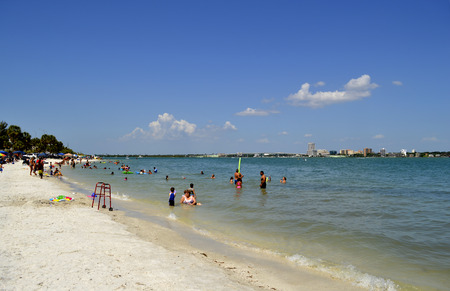 llave de sol: Sand Key in Florida, USA - May 10, 2015: tourists in the sea enjoying the sun Editorial
