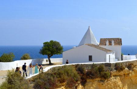 rocha: Senhora da Rocha, Algarve, Portugal - September 27, 2014: A romantic wedding ceremony in the sun Editorial