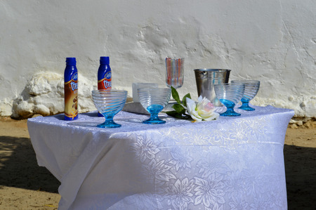 senhora: Senhora da Rocha, Algarve, Portugal - September 27, 2014: Table laid with glasses and drinks in Portugal Editorial