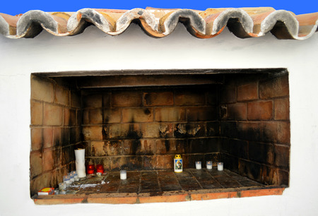 rocha: Votive candles at the Chapel of Nossa Senhora da Rocha Stock Photo