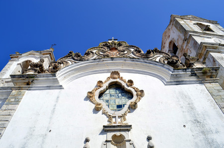 stonework: Lagos, Algarve, Portugal - October 1, 2014: A detail view of the ornate stonework on St Anthonys Church in Lagos Portugal Editorial