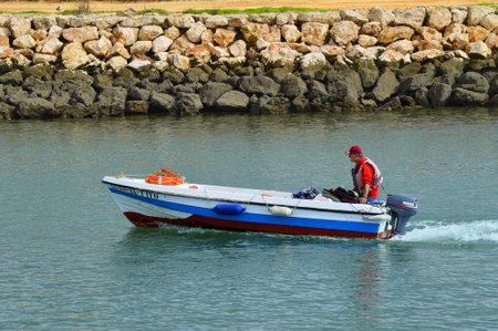 barlavento: Lagos, Algarve, Portugal - October 28, 2015: Motor boat on the Bensafrim river in Lagos harbour Editorial