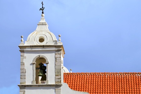 barlavento: Lagos, Algarve, Portugal - October 28, 2015 : The historical Santa Maria Church bell tower in Lagos Editorial