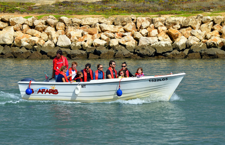 barlavento: Lagos, Algarve, Portugal - October 28, 2015: Seafaris motor boat with tourists on the Bensafrim river in Lagos harbour