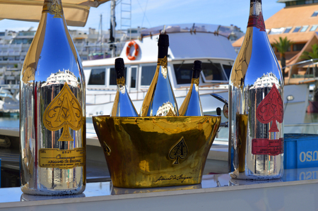 affluence: Vilamoura, Algarve, Portugal - October 26, 2015: Armand De Brignac Ace Of SpadesBrut Champagne bottles and ice bucket outside a restaurant in Vilamoura