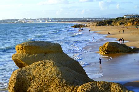 gale: Tourists enjoying the late evening sun on Praia Da Gale Beach