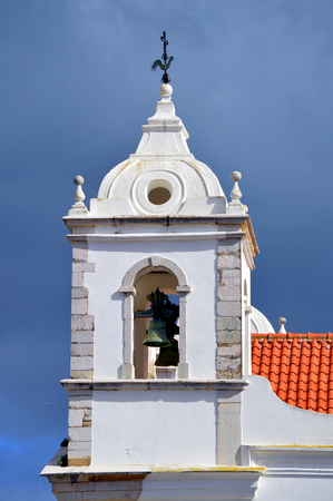 bell tower: The historical Santa Maria Church bell tower in Lagos Stock Photo