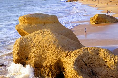 da: Tourists enjoying the evening sun on Praia Da Gale Beach
