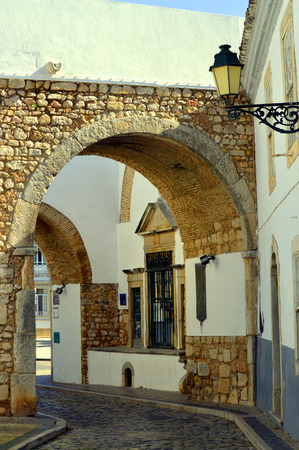 surrounding wall: Exit arch through the surrounding wall out of Faro old town