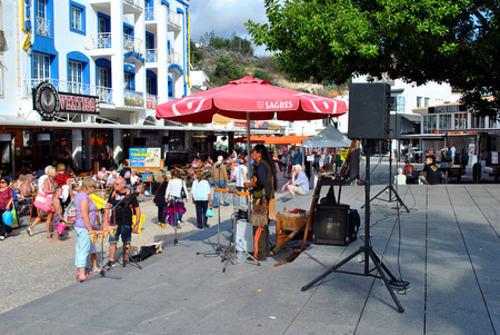busker: Albufeira, Algarve, Portugal - October 26, 2015 : Busker in the old town of Albufeira, Portugal Editorial
