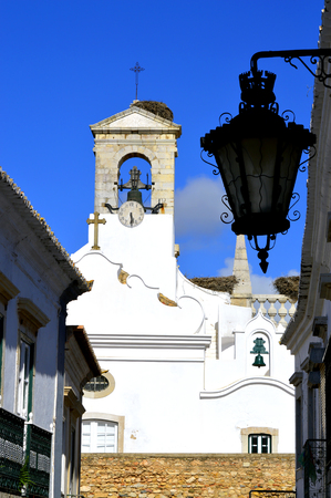 surrounding wall: Bell tower on the surrounding wall around Faro old town Stock Photo