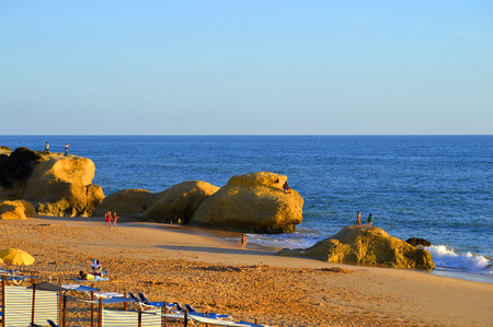 Tourists enjoying the evening sun on Praia Da Gale Beach