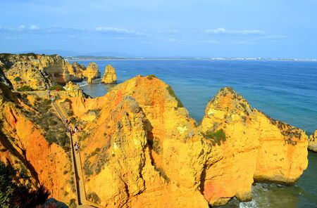 barlavento: Ponta Da Piedade, Algarve, Portugal - October 1, 2014 : Tourists exploring the Ponta Da Piedade spectacular rock formation in Portugal