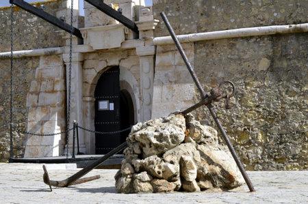 draw bridge: Lagos, Algarve, Portugal - October 28, 2015 : An anchor outside the historical Forte da Ponda da Bandeira in Lagos