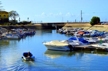 motor boats: Faro, Algarve, Portugal - October 29, 2015 : Motor boats moored in Faro Marina