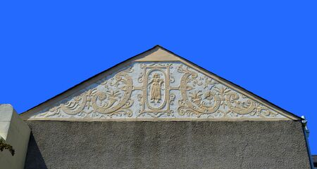 house gable: Conwy, Wales, United Kingdom - June 22, 2014 : Ornate plasterwork on the gable end of a house in Wales