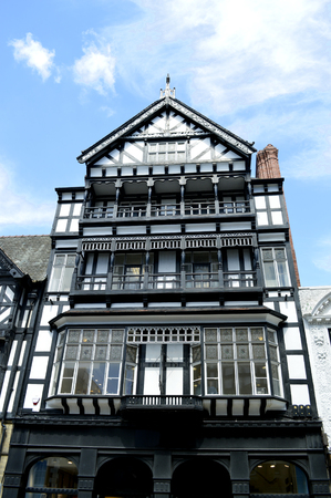 tudor: Chester, England, UK, Europe - May 26, 2014 : Tudor black and white timber frame house on Eastgate street in Chester City centre