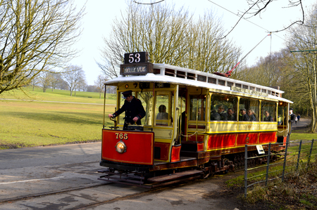 driven: Prestwich, Manchester, England, UK - March 13, 2016 : Tram number 765 being driven in Heaton Park. Editorial