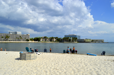 pinellas: Ben T Davis Beach, Florida, USA - May 12, 2015 :Tourists enjoying the beach on a sunny day