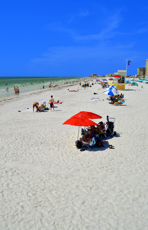 pinellas: Clearwater Beach, Florida, USA - May 12, 2015 : Tourists on the beach enjoying the sun