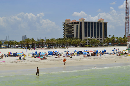 pinellas: Clearwater Beach, Florida, USA - May 12, 2015:tourists on the beach enjoying the sun Stock Photo