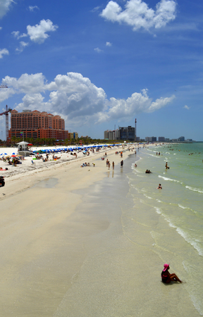 pinellas: Clearwater Beach, Florida, USA - May 12, 2015 :Tourists on the beach enjoying the sun Editorial