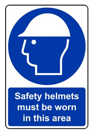 unauthorised: Safety helmets must be worn in this area Stock Photo