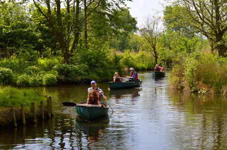 mere: Martin Mere, Lancashire, England, UK - May 29, 2016 : Tourists canoeing through the wetlands of Martin Mere