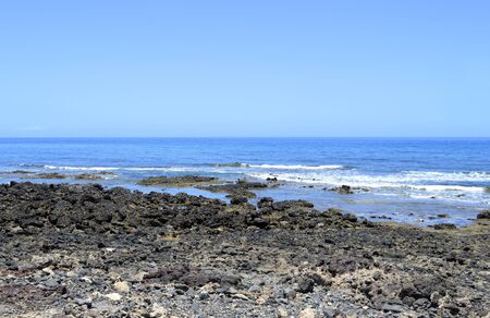playa: Playa De Las Americas beach volcanic rock in Tenerife