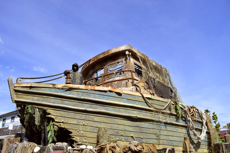 Shipwrecked boat in a harbour