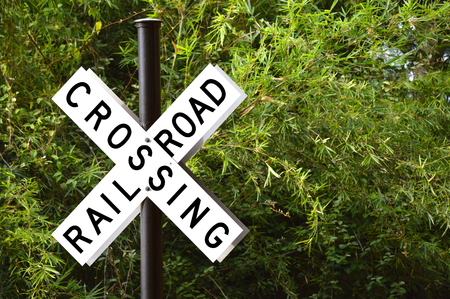 railroad crossing: Railroad crossing with barrier or gate ahead