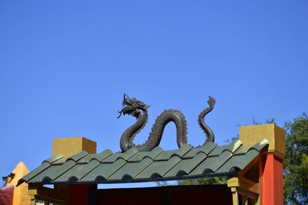 Chinese dragon on the roof of a house