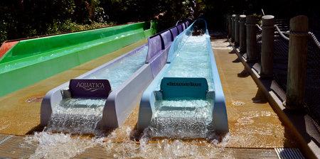 breakaway: Aquatica water park, Orlando, Florida, USA - October 23, 2016: Tourist on Breakaway Falls adventure slide in Aquatica water park Editorial