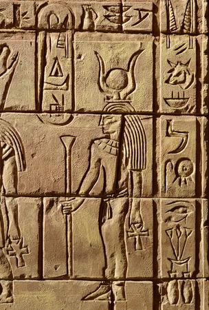 ra: Egyptian hieroglyphics Hathor was the daughter of Ra and the patron goddess of women Stock Photo