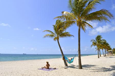 Tourists on the beach enjoying the sun Stock Photo
