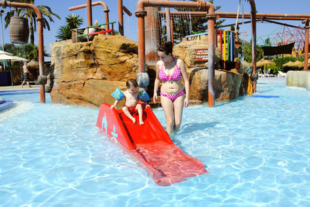 Water park, Fuengirola, Spain, Europe - September 12, 2012: Mother and child enjoying the fun in a water park Editorial